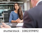 focused indian female customer... | Shutterstock . vector #1082359892