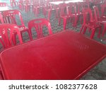 red plastic chair lay on the... | Shutterstock . vector #1082377628