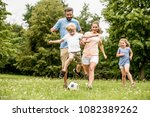 family playing soccer in the... | Shutterstock . vector #1082389262