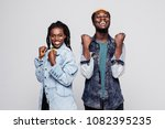 portrait of a happy young afro... | Shutterstock . vector #1082395235