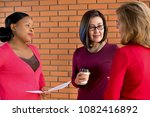 Small photo of Group of casual multiethnic women discussing problems, listening and encouraging their friend