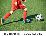 child soccer player and ball on ... | Shutterstock . vector #1082416952