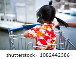 asian little girl in orange... | Shutterstock . vector #1082442386