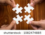 close up of four hands holding... | Shutterstock . vector #1082474885