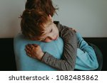 father comforting sad child ... | Shutterstock . vector #1082485862