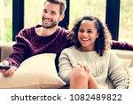 couple watching a tv show... | Shutterstock . vector #1082489822