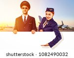 the pilot and stewardess hold... | Shutterstock . vector #1082490032