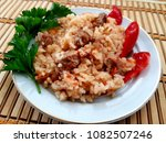 appetizing rice with vegetables ... | Shutterstock . vector #1082507246