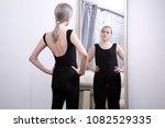 the girl looks at her...   Shutterstock . vector #1082529335