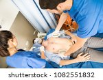 team of paramedics carrying out ... | Shutterstock . vector #1082551832