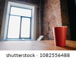 red paper disposable glass on a ...   Shutterstock . vector #1082556488