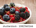 abundance berries in a white...   Shutterstock . vector #1082560166