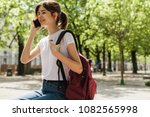 hipster pretty student making a ... | Shutterstock . vector #1082565998