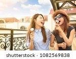 happy girls enjoy ice cream and ... | Shutterstock . vector #1082569838