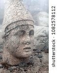 Small photo of Ancient ruined stone statue of King Antiochus I Theos on the top of Nemrut mount, Anatolia, Turkey