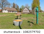 Manual water pump with old bowl on the site of the open-air museum in Kluki village. Poland