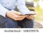 Small photo of Businessman Using Tablet Computer in park