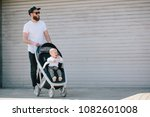 Father Walking With A Stroller...