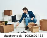 man with laptop sits on two... | Shutterstock . vector #1082601455