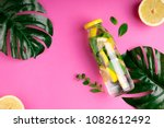 monstera leaves and bottle... | Shutterstock . vector #1082612492