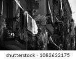 Stock photo barcelona old city houses with with drying laundry and catalonia flag black and white photo 1082632175