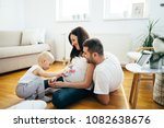 pregnant woman and her husband... | Shutterstock . vector #1082638676
