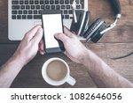 man using smartphone on old... | Shutterstock . vector #1082646056