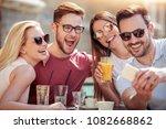 friends having a great time in... | Shutterstock . vector #1082668862
