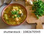 liquid saturated hot pea soup... | Shutterstock . vector #1082670545