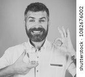 man with long beard hold water...   Shutterstock . vector #1082676002