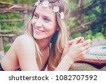 beautiful hipster girl lying in ... | Shutterstock . vector #1082707592