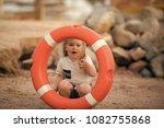 kid looking through orange life ... | Shutterstock . vector #1082755868