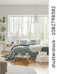white fur on green bed in cozy... | Shutterstock . vector #1082798582