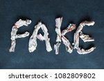 word fake made of scraps of... | Shutterstock . vector #1082809802