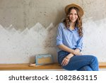 young attractive stylish woman... | Shutterstock . vector #1082863115