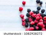 fresh berries on marble table ... | Shutterstock . vector #1082928272