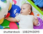 sweet baby playing toys on the... | Shutterstock . vector #1082943095