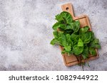 bunch of fresh mint on cutting... | Shutterstock . vector #1082944922