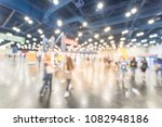 Small photo of Abstract blurred people at sport event in conventional hall, expo fair to pickup running t-shirt. Wide view bohek crowd of people 5K, 10K, half, full marathon race preparation in Houston, Texas, USA
