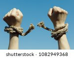 Hands Tearing Shackles The...