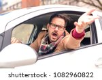 attractive man yelling through... | Shutterstock . vector #1082960822