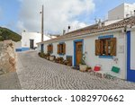 village street with residential ... | Shutterstock . vector #1082970662