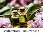 essential oil. bottle with oil. ... | Shutterstock . vector #1082994815