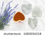 cup of flavored tea and blue... | Shutterstock . vector #1083056318