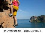 female rock climber climbing on ... | Shutterstock . vector #1083084836