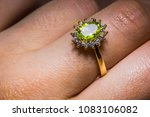 precious golden ring with olive ... | Shutterstock . vector #1083106082