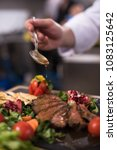 chef hand finishing steak meat... | Shutterstock . vector #1083125642