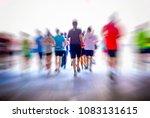 marathon runners in the city   Shutterstock . vector #1083131615