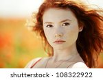 young beautiful girl in poppy field - stock photo