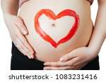 pregnant woman with red heart... | Shutterstock . vector #1083231416